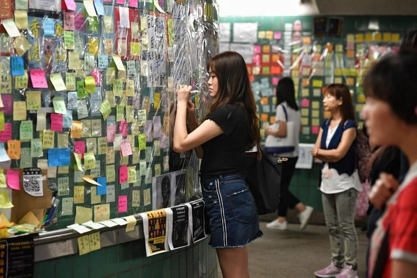 """In Tai Po, a district about halfway between the downtown area and the border with China, an underpass was converted into a """"Lennon tunnel"""", with pastel yellow, blue, pink and white messages across the walls."""