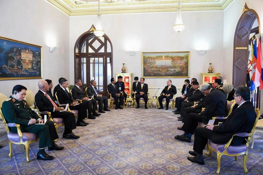 Officials and members of the Asean Defence Ministers' Meeting during a call on Thailand's Prime Minister Prayut Chan-o-Cha (centre) on July 11, 2019.