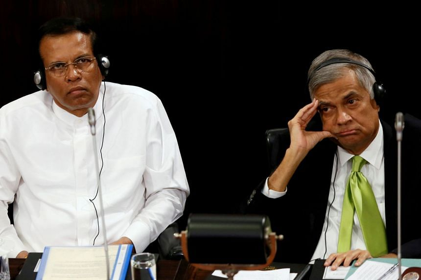 Sri Lanka's President Maithripala Sirisena and Prime Minister Ranil Wickremesinghe look on during a Parliament session in a file photo.