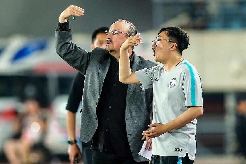 Dalian Yifang's new head coach Rafael Benitez relying on a translator in their match against Henan Jianye last Sunday. He has contrasted his warm welcome with his troubled tenure at Newcastle.