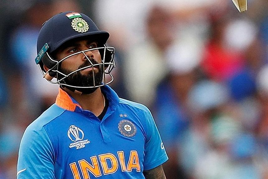 India captain Virat Kohli is upset after losing his wicket for one during the World Cup semi-final clash against New Zealand on Wednesday. The two-time world champions were stunned by the Black Caps, losing by 18 runs. PHOTO: REUTERS