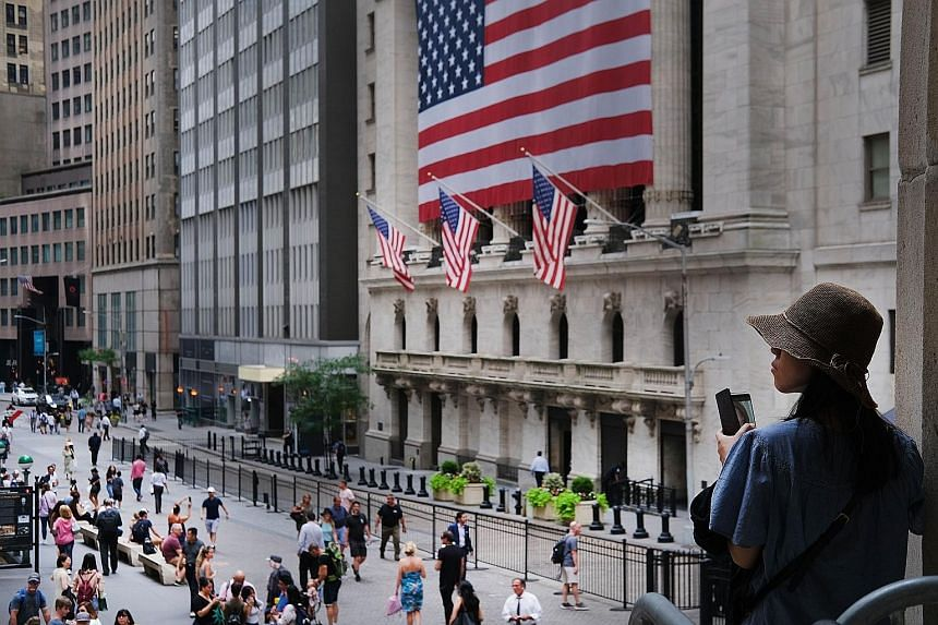 The New York Stock Exchange on Wall Street. The Nasdaq Composite Index, Dow Jones Industrial Average and S&P 500 surged to all-time intra-day records on Wednesday, following the release of United States Federal Reserve chairman Jerome Powell's congre