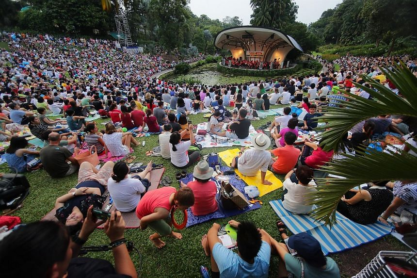 Attendees at the Straits Times Concert in the Gardens last year. The hour-long concert this year will see the Singapore Symphony Orchestra performing a selection of classics. Freebies will be distributed from 4pm. ST FILE PHOTO