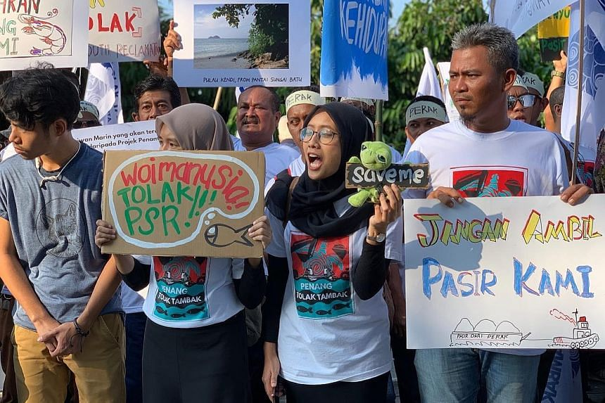 Fishermen from Penang and Perak demonstrating in Kuala Lumpur yesterday against plans for three man-made islands at the border of the two northern states which they say will curtail the livelihoods of about 10,000 people. ST PHOTO: SHANNON TEOH