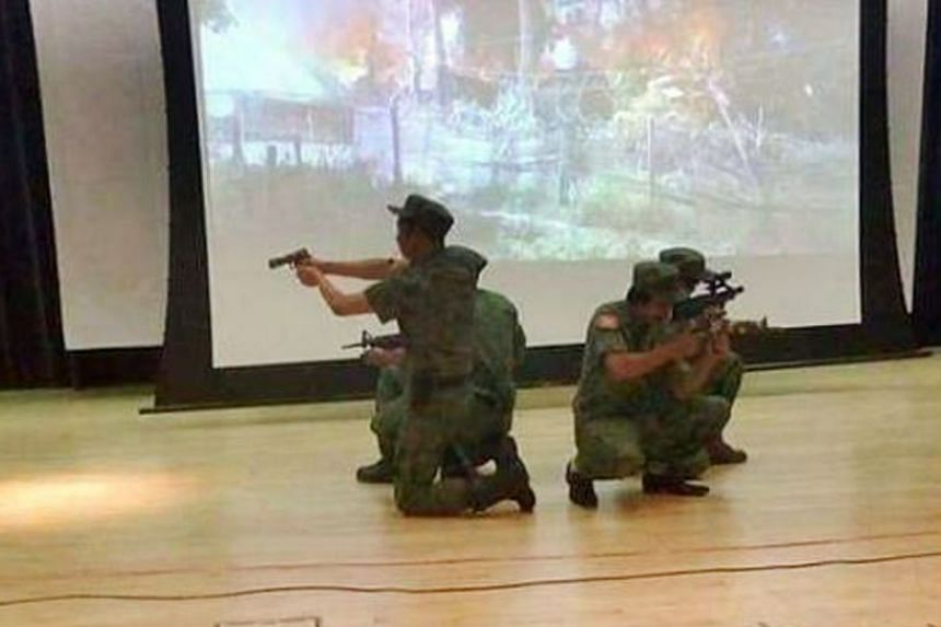 Pictures of the Singapore event show actors dressed in military uniforms and holding replica firearms on stage.