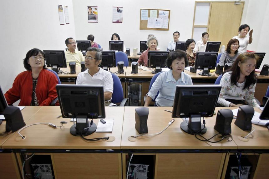 A class of older Singaporeans attending Microsoft Powerpoint lessons.