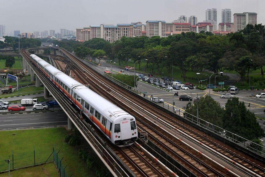 An MRT train passes by Ang Mo Kio Avenue 8.