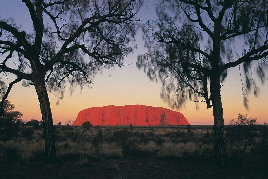 With a ban on hiking Uluru set for October, tourists are making a last-ditch pilgrimage to set foot on the rock before it's illegal.