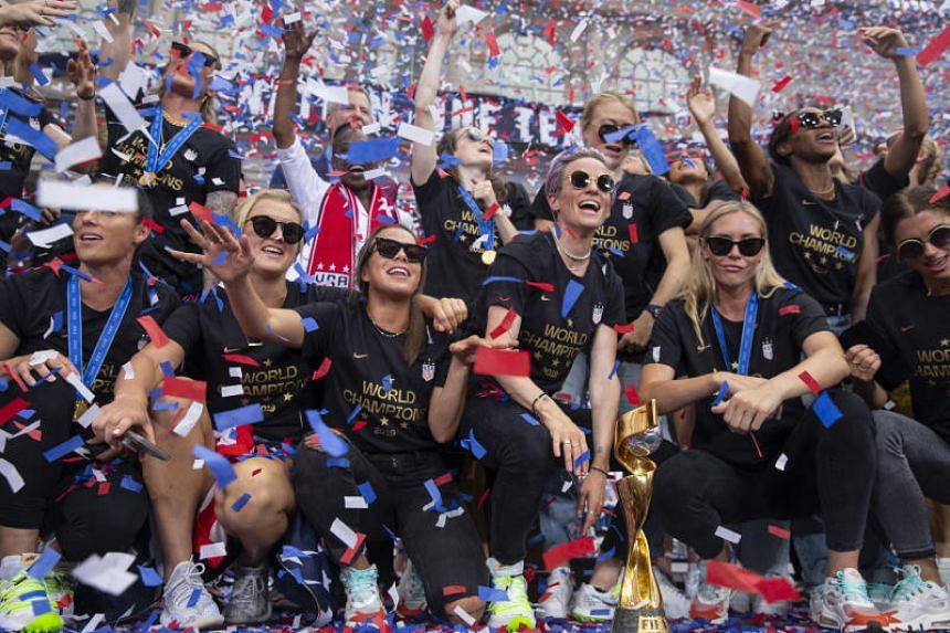 Members of the World Cup-winning US women's national soccer team at City Hall after their celebratory parade in New York, on July 10, 2019.