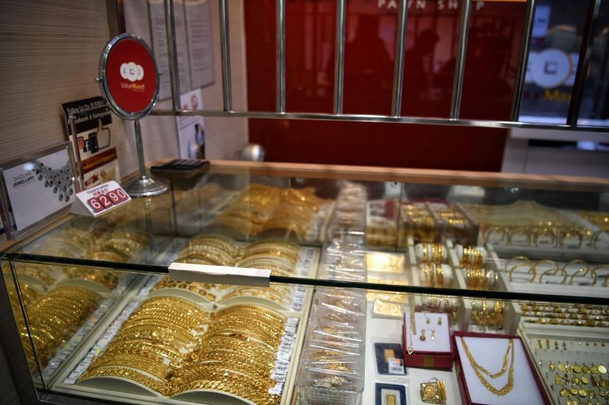 While business appeared to have returned to normal, a piece of masking tape covered the cracked display case where the robber slammed his chopper on the display.
