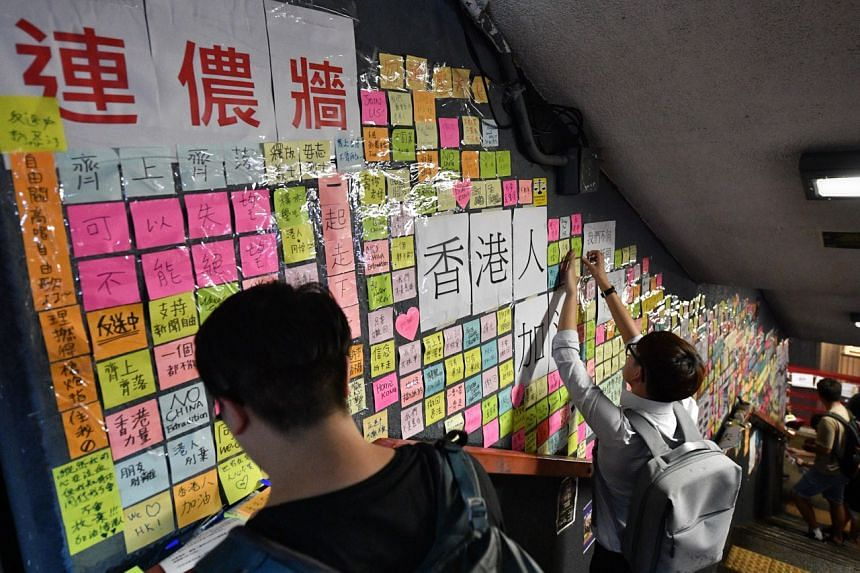 The Lennon Wall near the memorial service for Marco Leung on July 11, 2019.