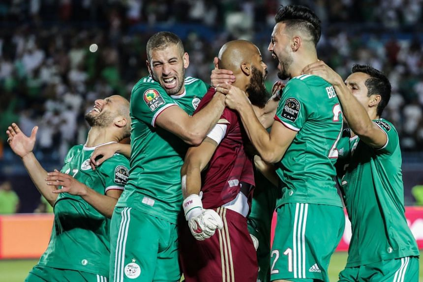 Algeria players celebrate after the final whistle.
