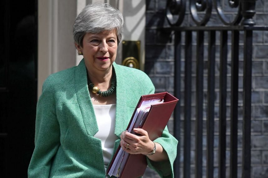 Theresa May departs her official residence in 10 Downing Street to attend Parliament.