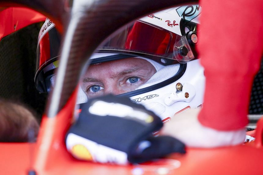 Vettel in the team garage during the second practice session.