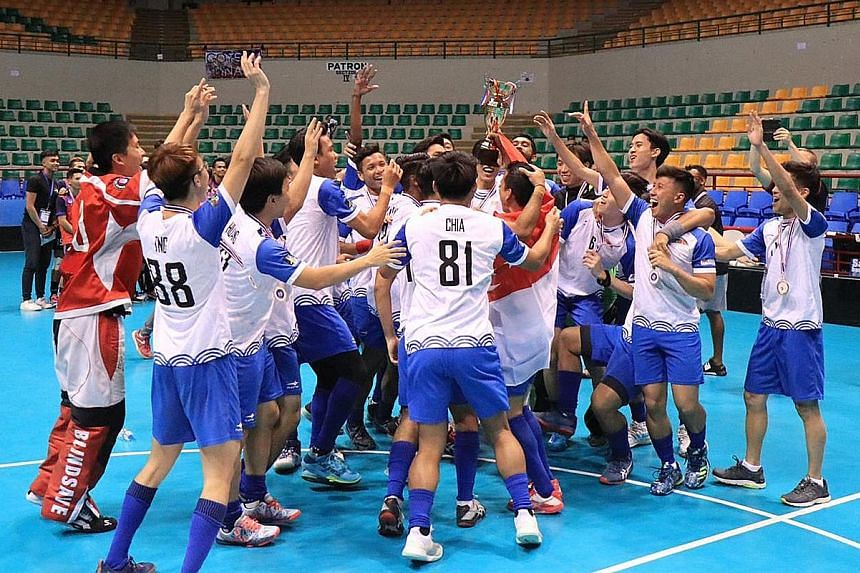 A jubilant Singapore with the AOFC Cup after defeating Thailand 17-1 in the final yesterday at the Alonte Sports Arena in Binan, the Philippines.