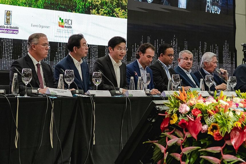 National Development Minister Lawrence Wong (third from left), in his speech at the 10th World Cities Summit Mayors Forum, says Singapore tries very hard to avoid segregation by race or income.