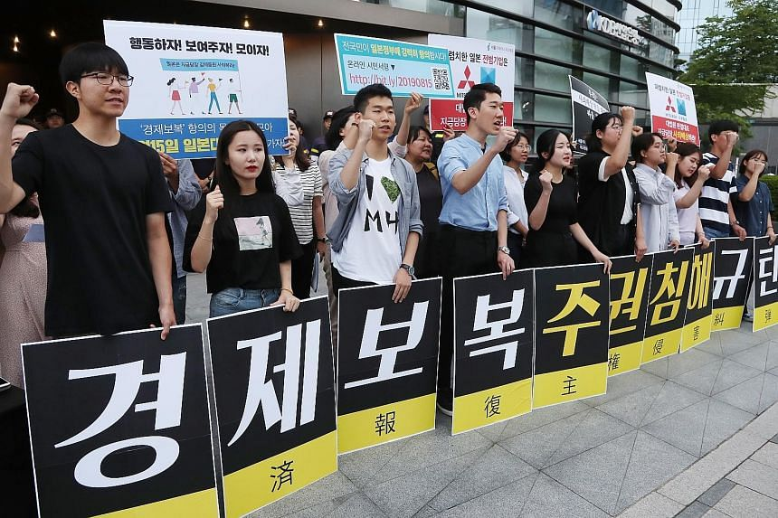South Korean activists protesting against Japan's tightened controls on exports of high-tech materials to their country, in front of the Japanese Embassy in Seoul on Thursday. PHOTO: EPA-EFE