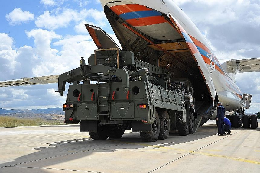 A photograph from the Turkish Defence Ministry showing a Russian military cargo plane arriving in the country yesterday with the first parts of a Russian S-400 anti-aircraft missile system. PHOTO: EPA-EFE