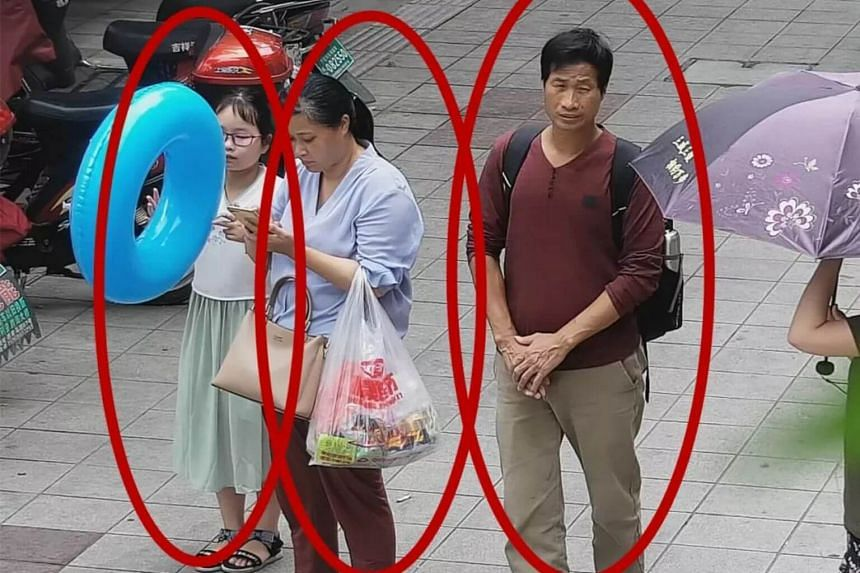 Surveillance image showing Zhang Zixin and the two tenants who took her away.