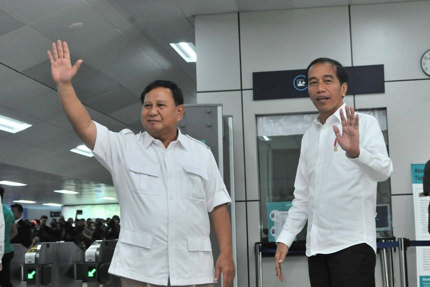 President Joko Widodo (right) met his former challenger Prabowo Subianto before taking a ride together on the country's first MRT line.