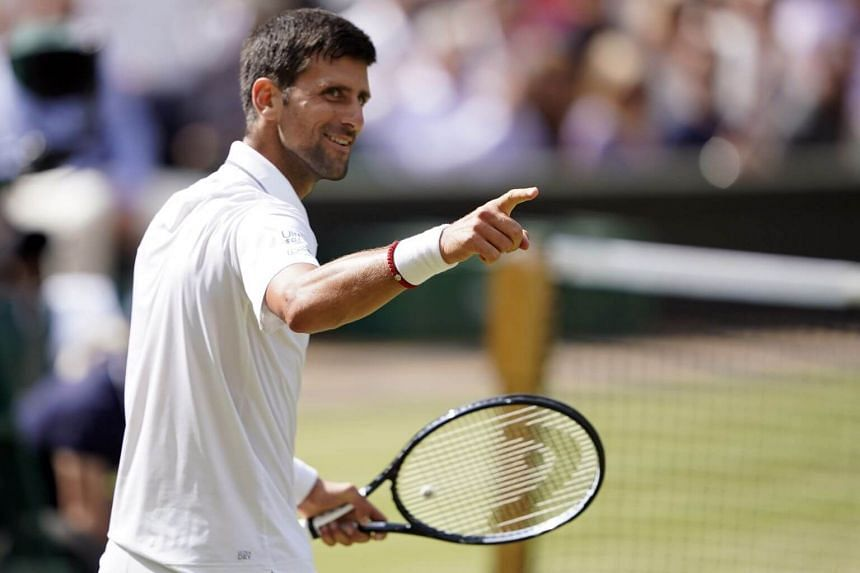 Novak Djokovic (above) celebrates his win over Roberto Bautista Agut in their semi final match during the Wimbledon Championships at the All England Lawn Tennis Club, in London, on July 12, 2019.