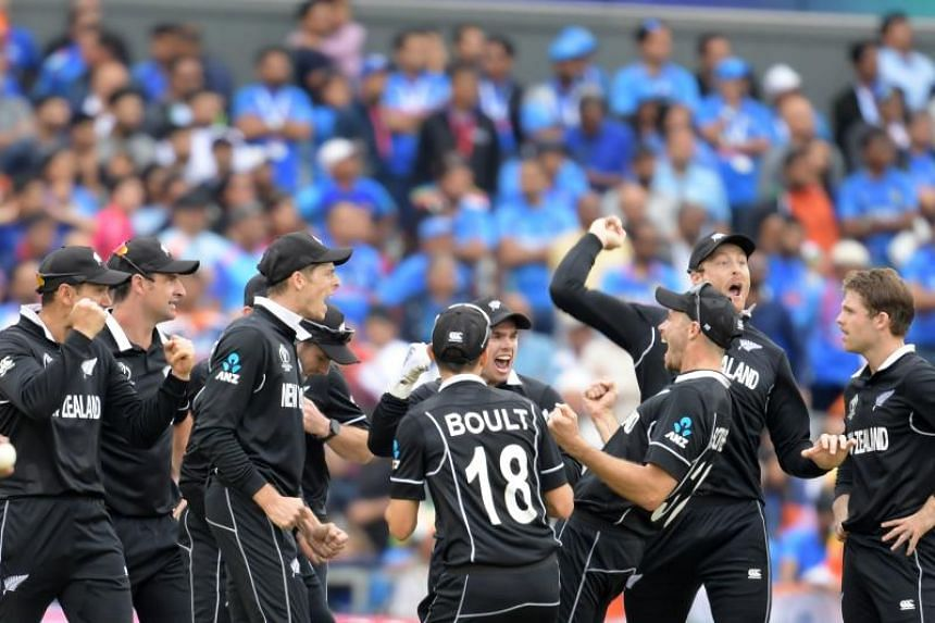 The New Zealand cricket team celebrates after winning against tournament favourites India during the 2019 Cricket World Cup on July 10, 2019.