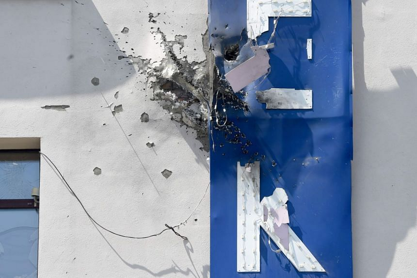 A close-up of the building's damaged facade, after it was attacked by an unknown person with a grenade-launcher.
