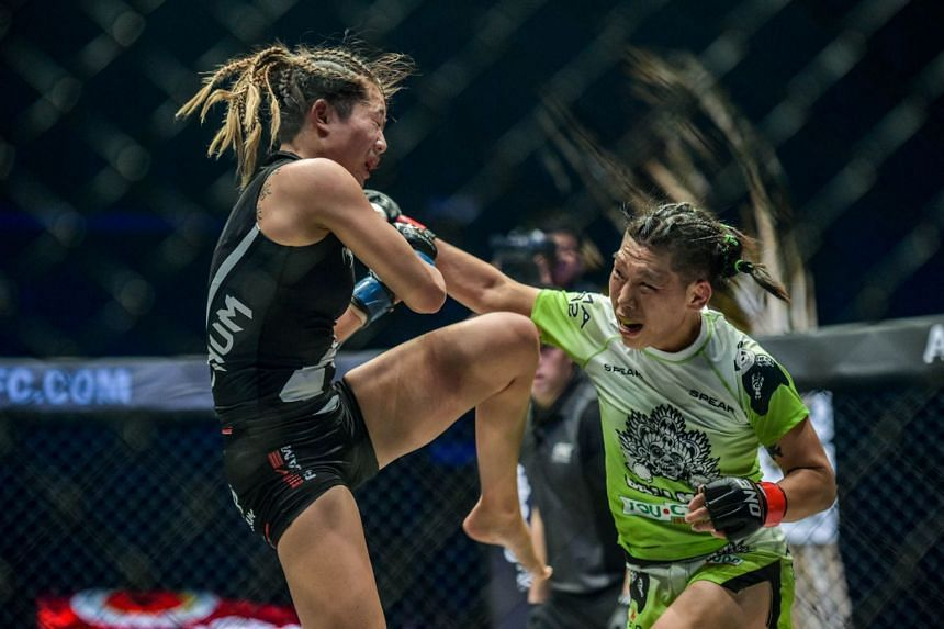Angela Lee (in black) lost her challenge for Xiong Jingnan's (in green/white) strawweight title at One Championship's A New Era event in Tokyo in March 2019.