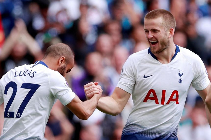 Dier celebrates a goal for Tottenham with Lucas Moura.
