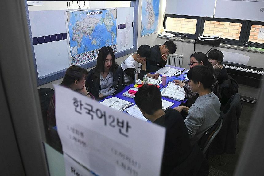 Students at Wooridul School in Seoul, one of seven special academies across South Korea offering defectors free education.