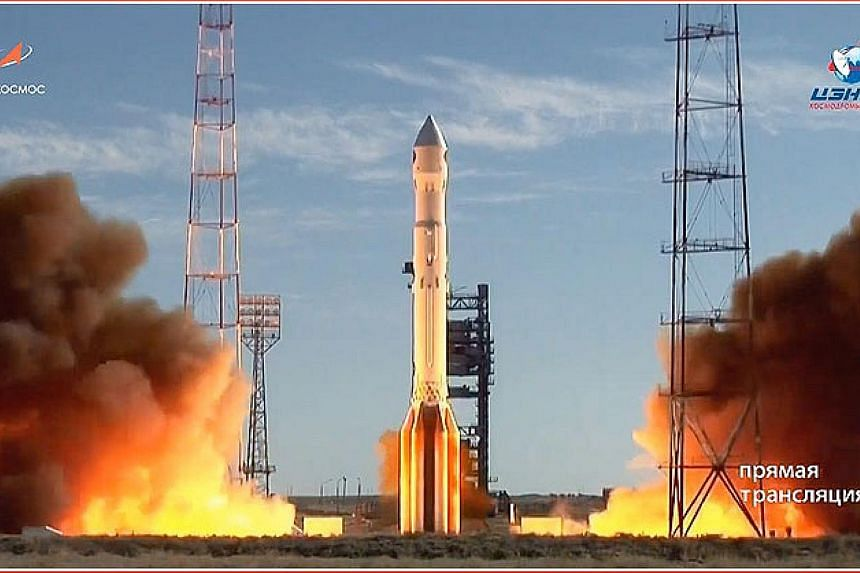 A Proton-M rocket carrying the Spektr-RG space observatory taking off from the cosmodrome in Baikonur, Kazakhstan.