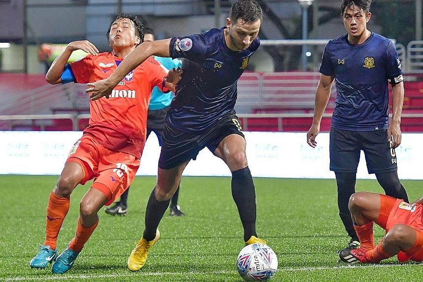 Hougang United striker Stipe Plazibat outmuscling Albirex Niigata captain Kyoga Nakamura in their Singapore Premier League match at the Jurong East Stadium yesterday. Hougang won 2-1 with Plazibat scoring twice, in the 25th and 31st minutes. ST PHOTO