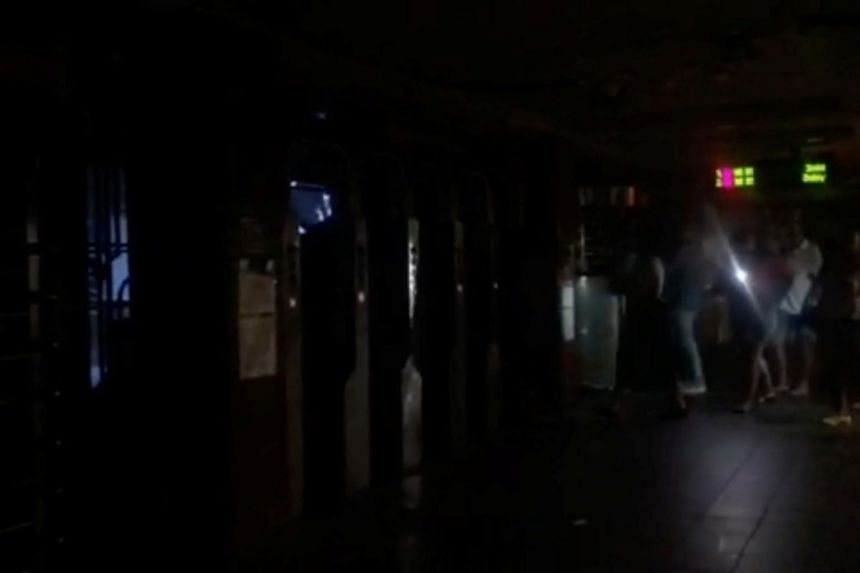 Passengers walking through the 66th Street subway station during a blackout caused by widespread power outages, in this still frame taken from video, in Manhattan on July 13, 2019.