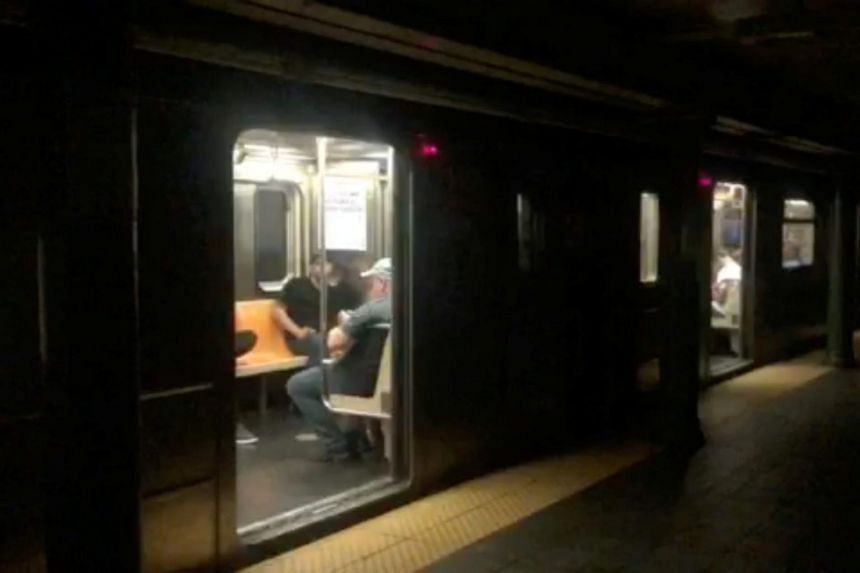 Passengers in a subway train at the 66th Street station during a blackout caused by widespread power outages, in this still frame taken from video, in Manhattan on July 13, 2019.