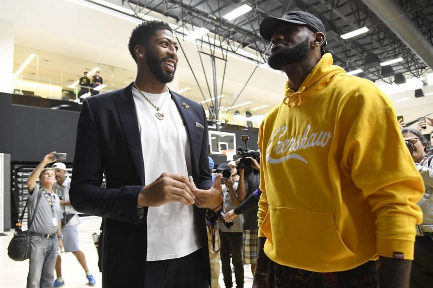 Anthony Davis (right) talks to LeBron James after a press conference where Davis was introduced as the newest player of the Los Angeles Lakers.