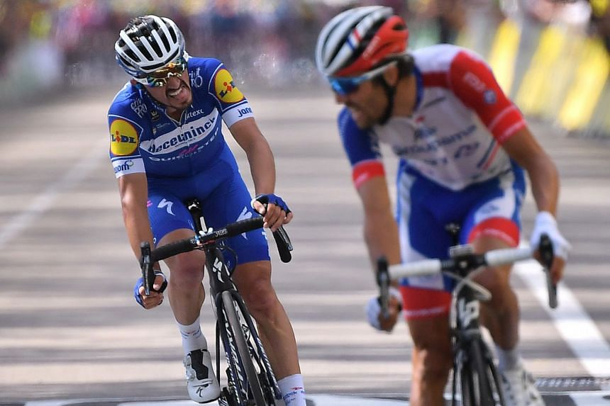 Julian Alaphilippe (left) and Thibaut Pinot react on the finish line.