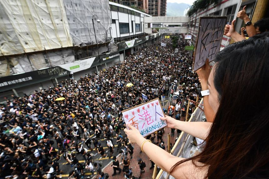 Hong Kongers holding up signs of encouragement during a protest on July 14, 2019.