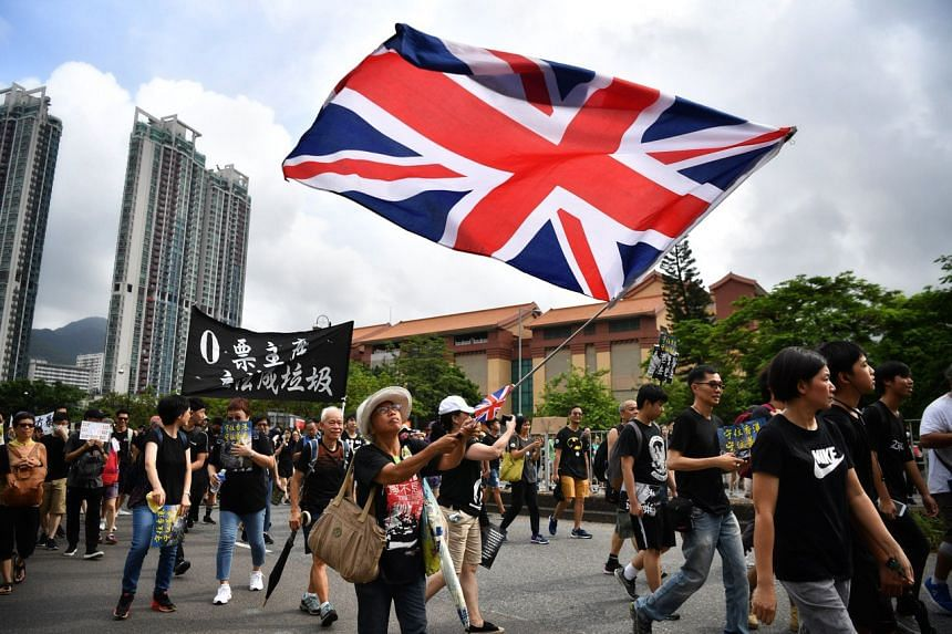 "Ms Alexandra Wong, affectionately known as ""Grandma Wong"" by the Hong Kong protesters, waving the Union Jack during a protest in Sha Tin on July 14, 2019."