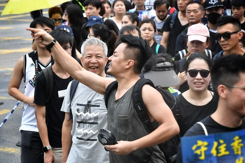 A protester berating police officers during a demonstration in Sha Tin, Hong Kong, on July 14, 2019.