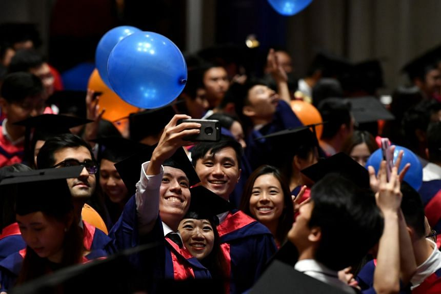 Graduating students taking a selfie at the commencement ceremony for the NUS Yong Loo Lin School of Medicine, on July 14, 2019.