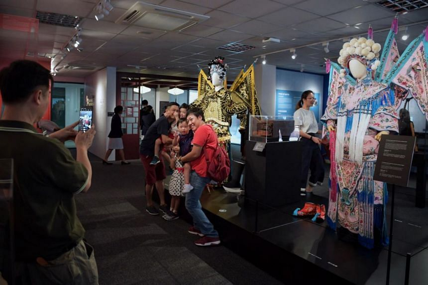 The upgraded Kreta Ayer Community Club features a new interactive heritage gallery where students from Anderson Secondary School and Gan Eng Seng School will act as guides.