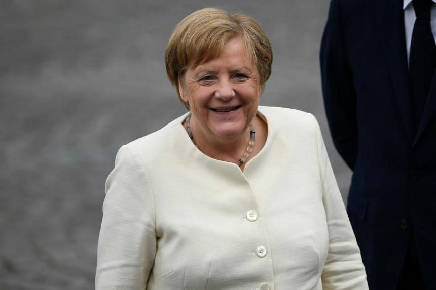 German Chancellor Angela Merkel arriving for the Bastille Day military parade on the Champs-Elysees in Paris on July 14, 2019.