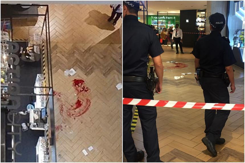 An eyewitness said she saw blood outside the ActionCity store at the basement 2 level of the mall.