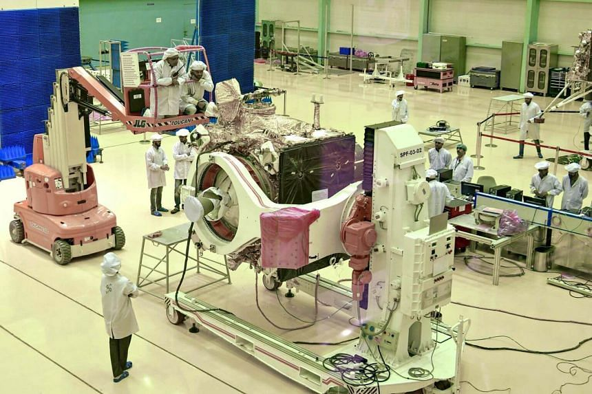 Indian Space Research Organisation scientists working on the orbiter vehicle of Chandrayaan-2 in Bangalore on June 12, 2019.