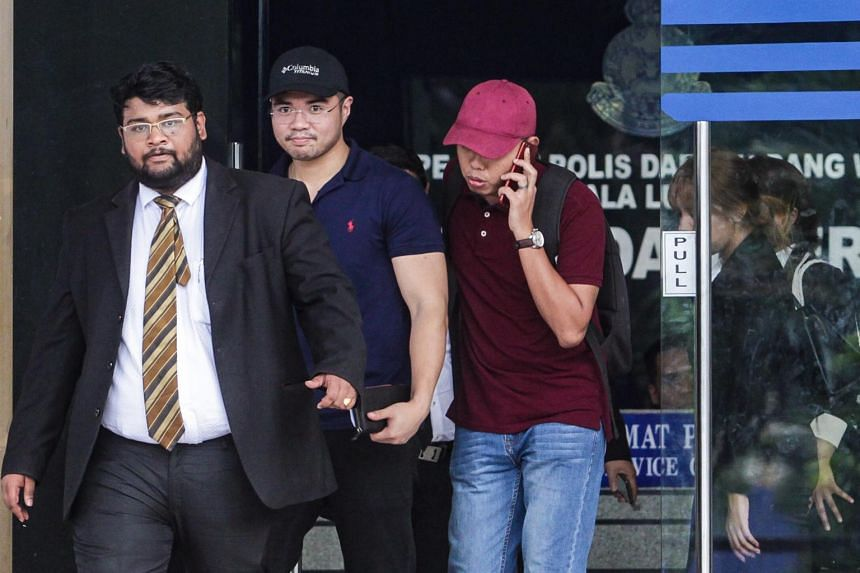 Haziq Abdullah Abdul Aziz (centre, blue), who was among the six arrested, had confessed on June 12, 2019 via social media that he was one of the men appearing in the video which implicated Economic Affairs Minister Azmin Ali.
