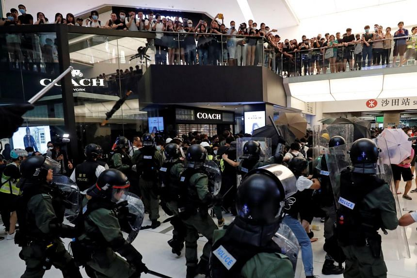 Tensions peaked when officers in riot gear entered New Town Plaza mall in Sha Tin and tried to disperse the crowd that was still milling about there, resulting in chaos.