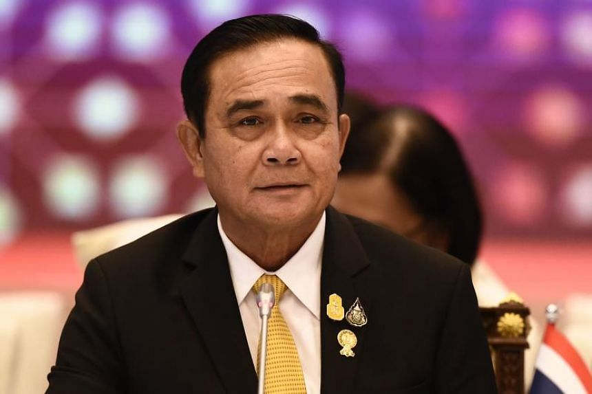 Thai coup leader's new Cabinet sworn in pledging loyalty to king