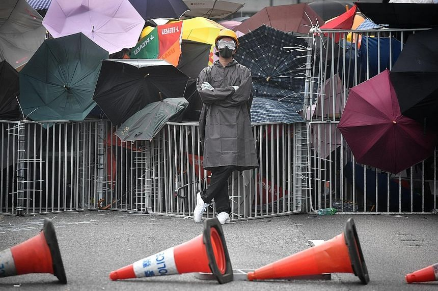 A protester standing defiantly in Hong Kong's Sha Tin district after a rally against a controversial extradition Bill on Sunday. ST PHOTO: CHONG JUN LIANG
