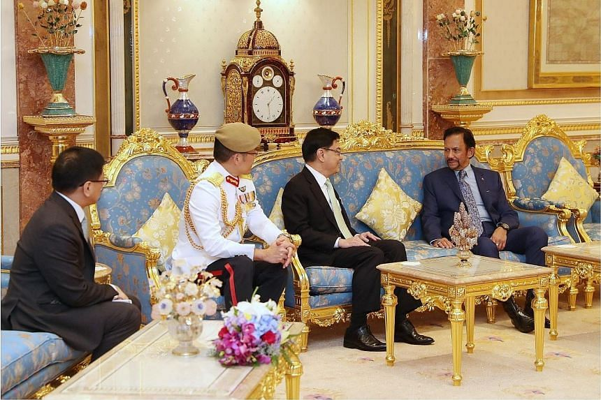 From far left: Singapore's High Commissioner to Brunei Lim Hong Huai, Chief of Defence Force Melvyn Ong, Deputy Prime Minister Heng Swee Keat and Brunei's Sultan Hassanal Bolkiah yesterday.