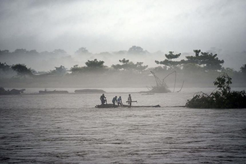 A tree being cleared in the flooded Manas river, following heavy rainfall in Baksa district of Assam, India, on July 15, 2019.